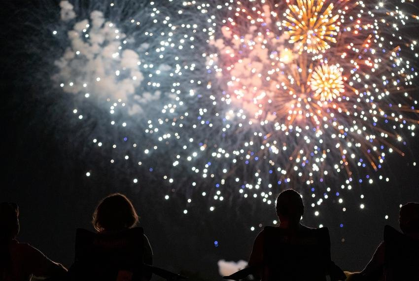 People watch a fireworks display from the parking lot of Church of the Springs in Dripping Springs on July 4, 2020.
