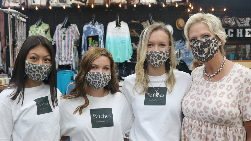 Wearing matching masks at the ribbon cutting ceremony Tuesday morning at Patches by Smith and Company are, from the left, Maraya Martinez, Hattie Schalla, Emily Luthor, and Kimbra Hill.