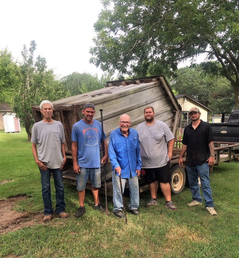 Pictured moving an outhouse to the Sealy Historical Park recently are, from the left,  Dennis Holder, Ryan Gassner, Leon Konvicka, Berl Gassner, and Daniel Griffen.