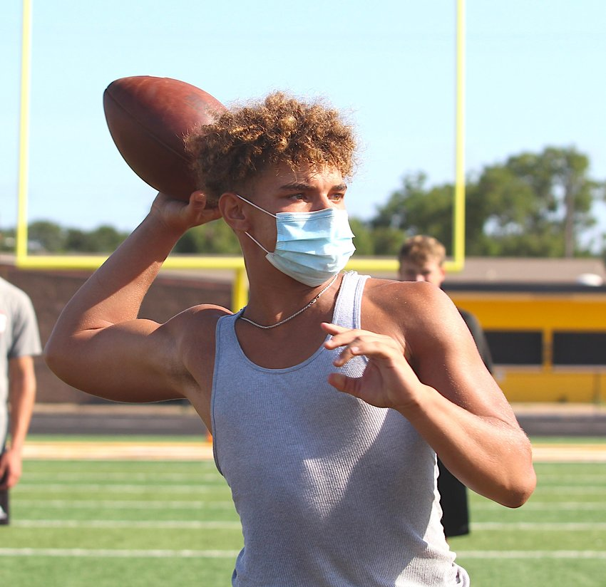 Sealy athletes were back to work at in-person workouts Monday morning following a second shutdown in the last three weeks but were able to run football drills in groups thanks to new guidelines from the UIL. Pictured is D'vonne Hmielewski gearing up for a passing attempt at T.J. Mills Stadium.