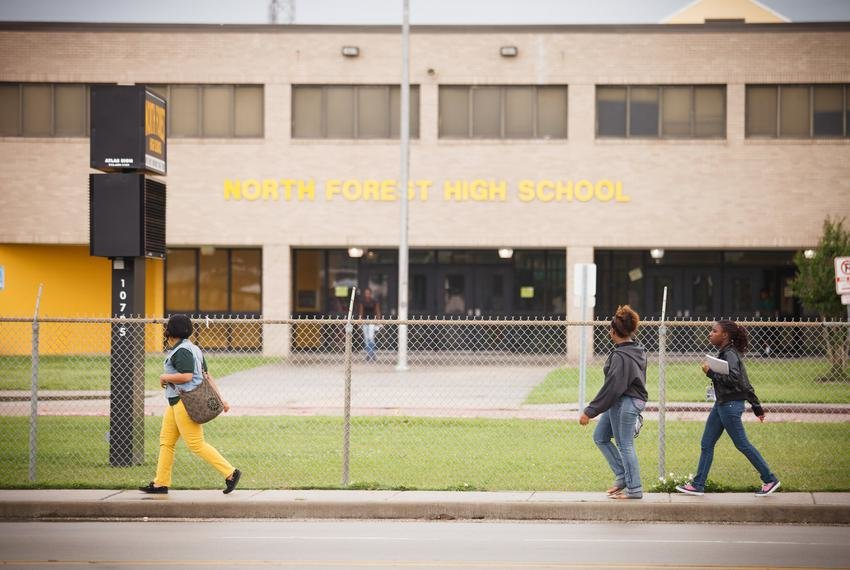 Students walk outside North Forest High School in Houston.