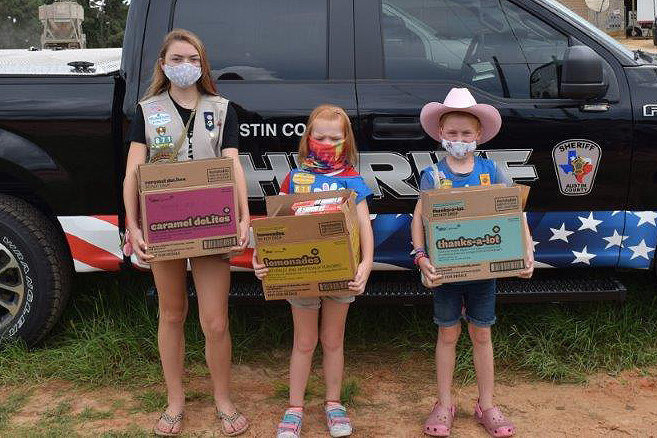 """On Wednesday, July 22, Doris Harrison and local Austin County Girl Scouts delivered several boxes of cookies to the Austin County Sheriff's Office showing appreciation of service to the community. """"The sheriff's office is very thankful for the support of our youth in the community,"""" Sheriff Jack Brandes said."""