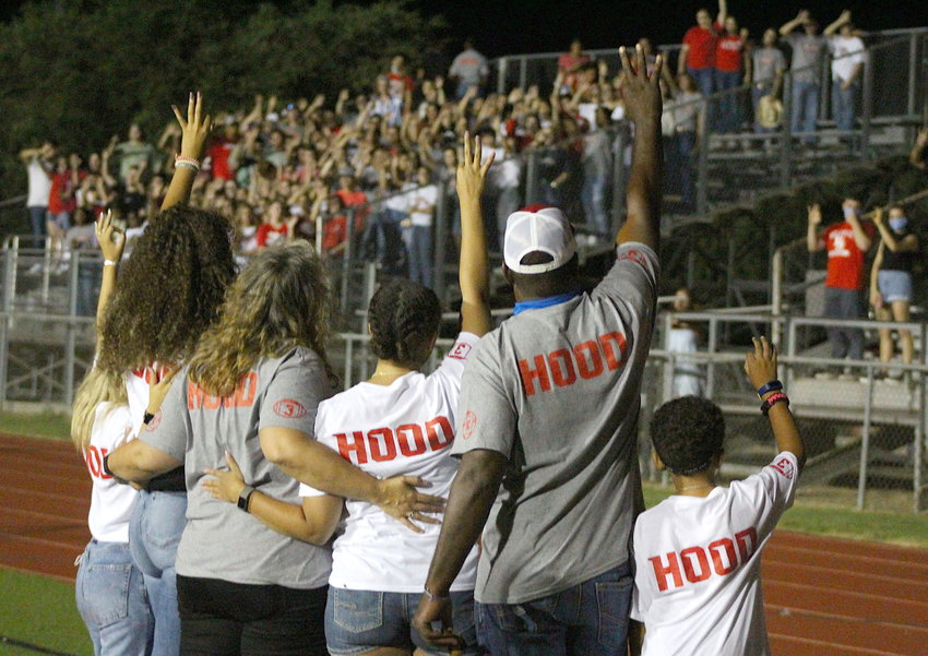 The Hood family held up Zach Hood's number three after balloons were released in his honor to end last Friday night's remembrance gathering at Bellville ISD Stadium. Pictured from the left are Zabrina, Susan, Shantel, Quentin and Stream Hood with the Brahma student section also holding up threes in the background.