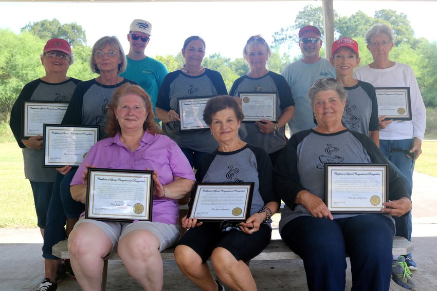 U.S. Rep. Michael McCaul (R-Texas) recently presented the members of the Java Gypsies with congressional certificates of recognition. Pictured with their certificates at the law enforcement shooting range are, from the left, (top row) Helen Burchfield, Carla Sayle, Hayden Reeves (son of police chief Jay Reeves), Elaine Coffey, Marsha Merrell, Jay Reeves, Fawncyne Worley, Heather Smith, (bottom row) Barbara Havemann, Antoinette Romano, and Carol Jean Kimich.
