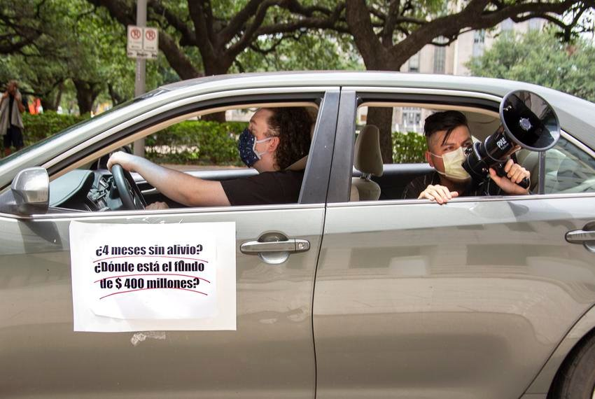 Latino workers gathered for a car protest to demand economic, rental and health relief Tuesday outside of Houston City Hall. Mayor Sylvester Turner announced a new rent relief program this week but opposed a mandatory eviction grace period.
