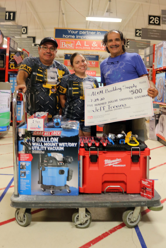 Twice a year, AL&M Building Supplies in Sealy offers a $500 shopping spree giveaway to customers. They recently presented the winners with their purchases. Pictured is winner Jeff Tevino, right, with his workers Joel and Fantazah Richie.