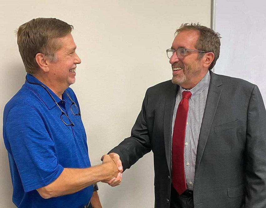 Bellville Hospital District Board Chair Michael Koehn, left, welcomes Daniel Bonk as the new CEO of Bellville Medical Center.