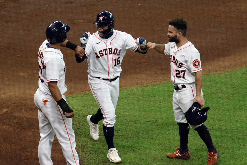 Houston's Aledmys Diaz, 16, is greeted by Michael Brantley, left, and Jose Altuve, right, after his three-run home run gave the Astros a 4-0 lead in the first inning over the Texas Rangers Thursday afternoon at Minute Maid Park. Houston won the game, 8-4, to win the series 2-1.