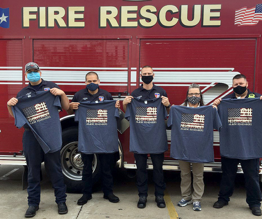 On Sept. 10, AL&M Building Supplies donated T-shirts to members of the Sealy Fire Department in remembrance of 9/11. Pictured are Jonathan Tollett, Joshua Bermea, Kevin Kramr, Debbie Hamner of AL&M, and Buddy Noack. The owners of AL&M Building Supplies are Mark and Alison Korell.