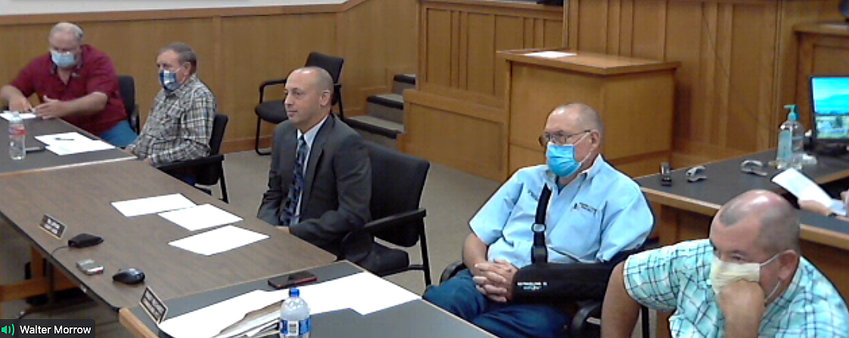 Austin County commissioners conduct a public hearing on the proposed tax rate for 2020-2021. Pictured in this image from a hearing broadcast online are Mark Lamp, Bobby Rinn, Tim Lapham, Randy Reichardt, and Chip Reed.