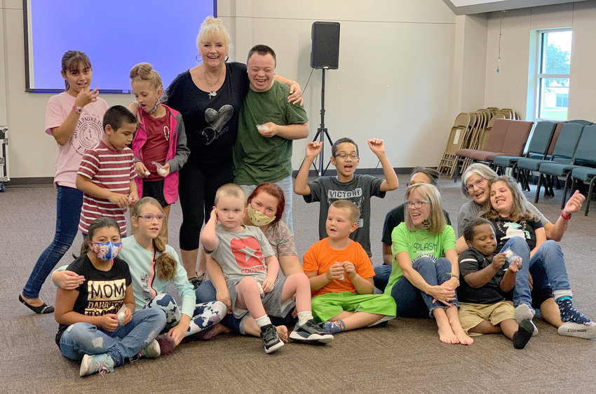 """Marsha """"Miss Marshmellow"""" Merrell (top, second from right) and her assistants Britni Machala, Melissa Ford, and Karen Wilkinson pose with a group of special needs students in the Chance to Dance class. Not pictured is special education teacher Helen Haby."""