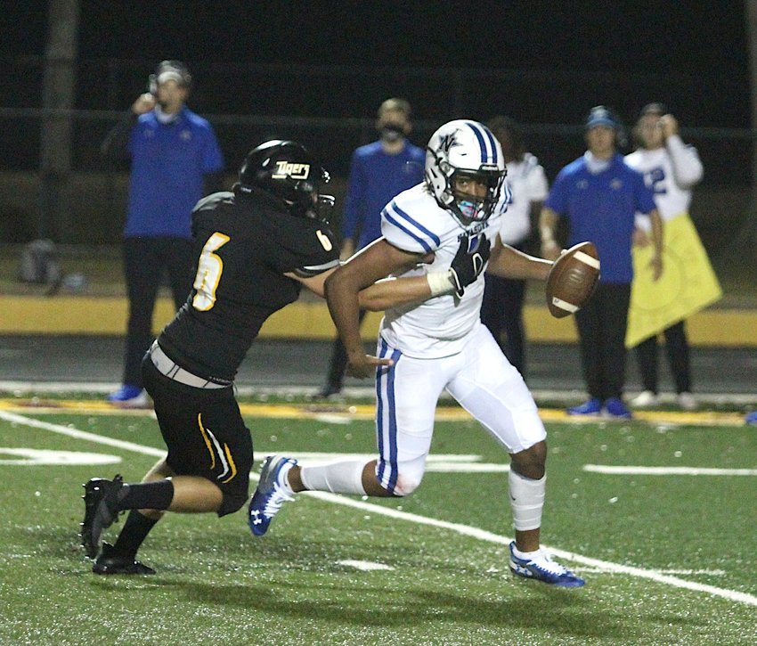 Brooks Redden was part of the defensive effort that secured three takeaways for the Sealy defense in the Tigers' 45-6 win over Somerset on the road last week. Pictured is Redden pursuing Navasota quarterback Ja'mar Jessie in Sealy's season opener on Sept. 4 at T.J. Mills Stadium.