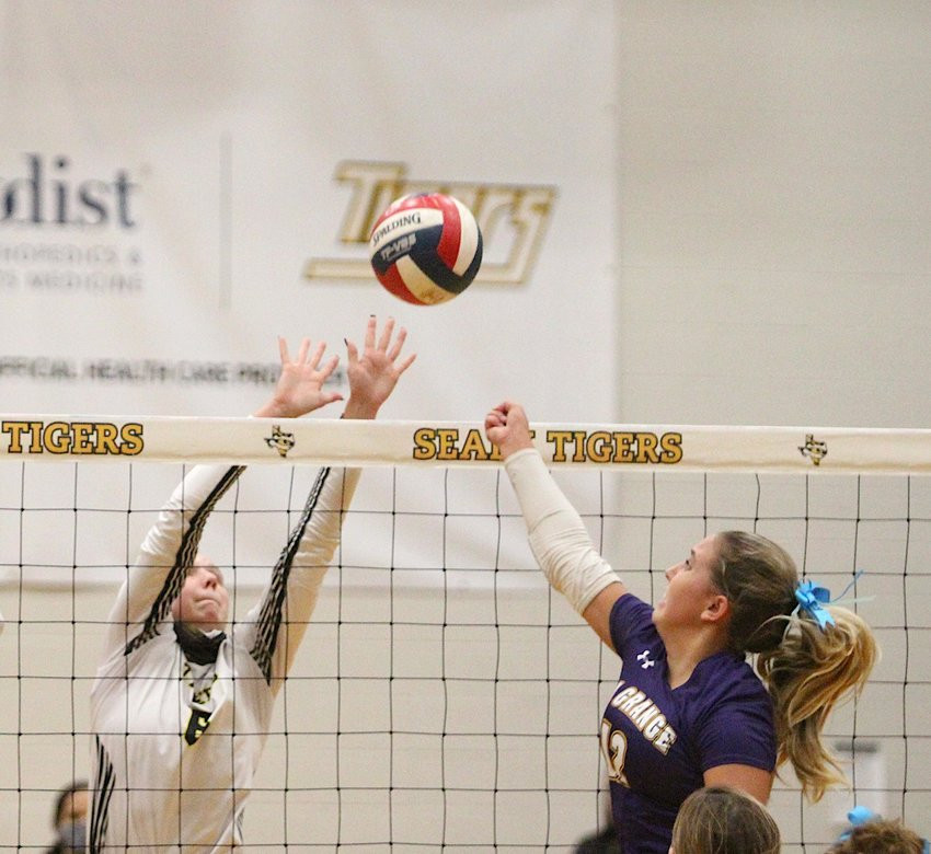 Breanna Brandes and the Sealy Lady Tigers collected a sweep over La Grange in its last non-district home game last Tuesday where Brandes contributed 13 assists, nine kills and two aces to the winning effort. Pictured are Brandes, left, and Lady Leopard Madison Fritz at the net during last Tuesday's contest.
