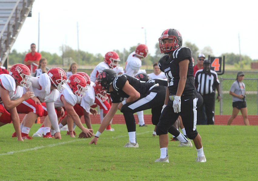 Bryan Maldonado's fumble recovery for a touchdown gave Brazos a two-possession lead late in the fourth quarter that helped the Cougars earn their first win of the season, 18-12, over Burton. Pictured is Maldonado lining up in a non-district game against St. John XXIII on Sept. 21, 2019.