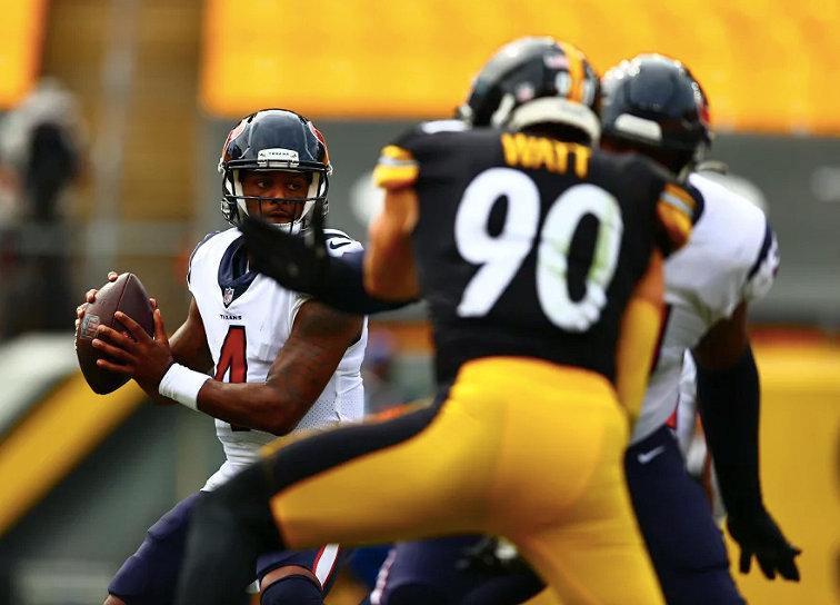 Houston Texans quarterback Deshaun Watson (4) is pressured by T.J. Watt of the Pittsburgh Steelers during Sunday's 28-21 loss at Heinz Field.