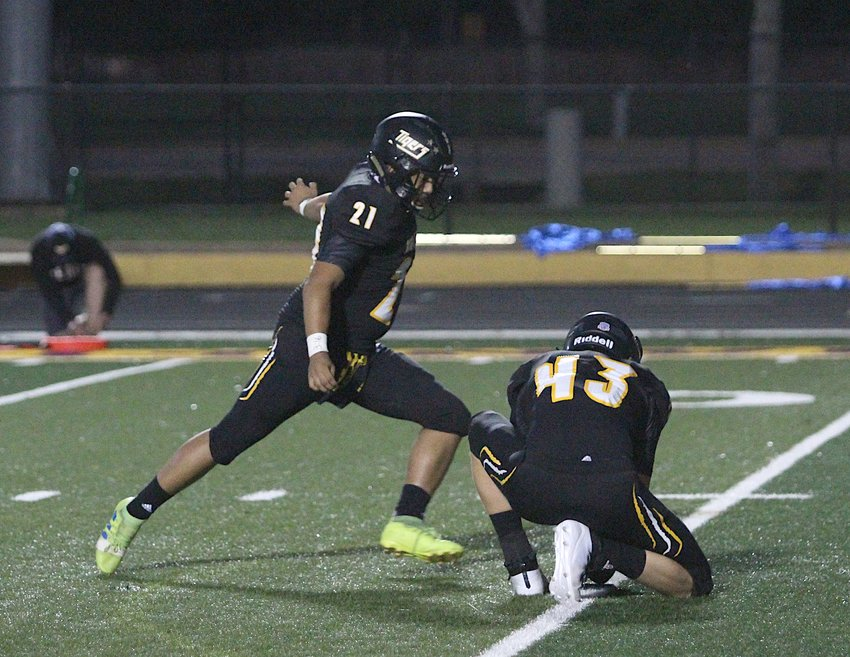Tiger kicker Joshua Paz delivered a 32-yard field goal with 23.7 seconds remaining to tie the game at 24 and send it to overtime.