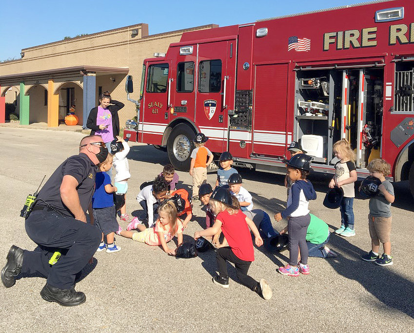 The Sealy Fire Department recently stopped at Creative Care Day Care for Fire Prevention Month activities. The firefighters showed the children how to stop, drop and roll.
