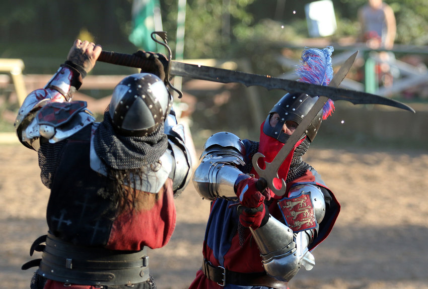 The Spanish, left, and English knights square off in battle during a jousting event.