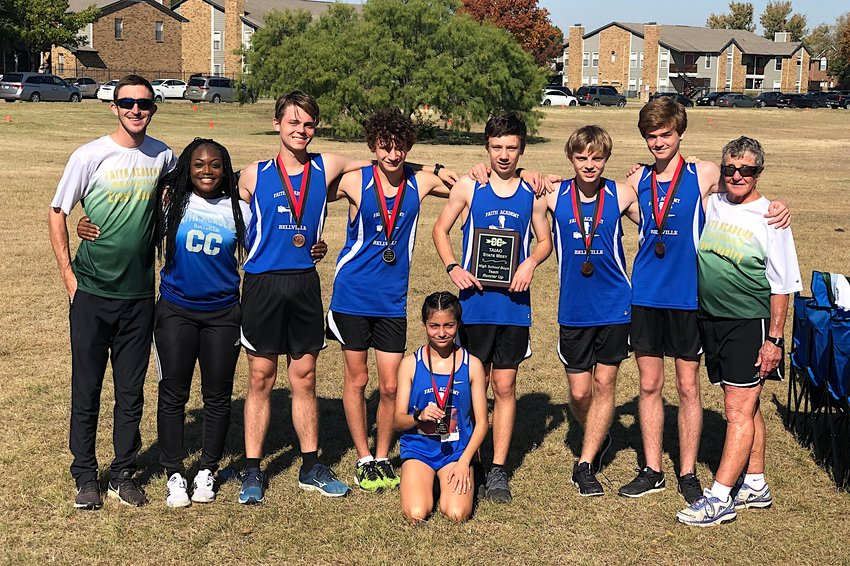 The Faith Academy cross country team wrapped up their season at the TAIAO state championship last Saturday at Buffalo Ridge Park in Haltom City. Pictured from left to right are assistant coaches Jacob Deramus and Brocquel Williams, runners Landen Bright, Beck Briggs, Eli Kubicek, Joshua Bright and John Poorman and head coach Ann Howarth. Kneeling in front is Summer Bright.