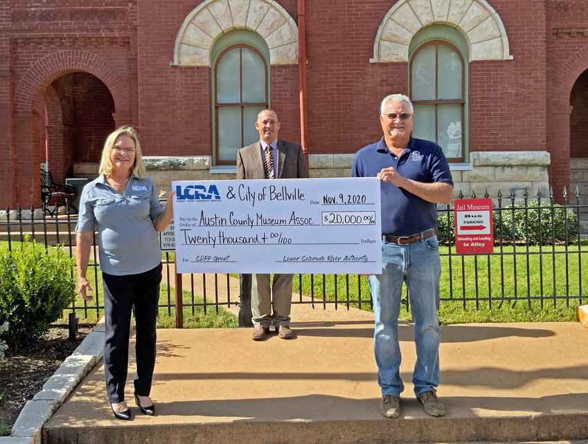 Lower Colorado River Authority Board Member Lori A. Berger, left, presents a $20,000 grant to the Austin County Museum Association to help preserve the historic former jail. The grant is part of LCRA's Community Development Partnership Program. Pictured from the left are Berger, County Judge Tim Lapham, and Bruce Noviskie, chairman, museum association board of directors.
