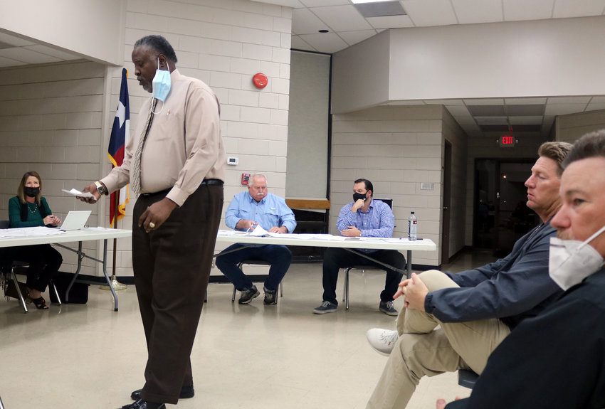 Llarance Turner, a project manager for Kaluza Inc., presents a land plan for Cane Belt Estates to the Sealy City Council during last Tuesday's meeting. Seated to the right are developers Scott Lease and Jim Garrett.