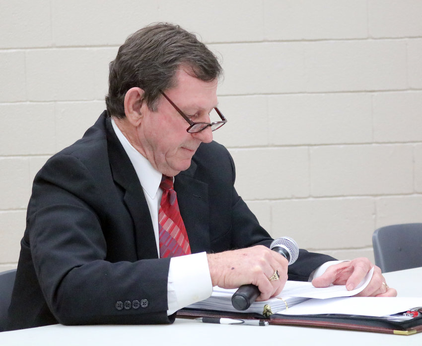 Sealy City Manager Lloyd Merrell reads a statement during a special meeting of the city council Monday night in which he asked them to let him do his job or else terminate his employment.