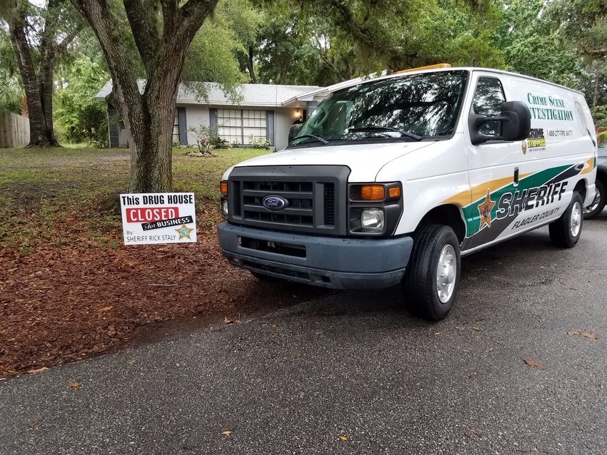 FCSO CSI van outside of the now closed drug house