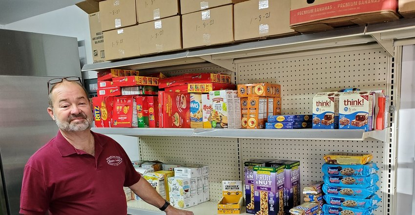 Pastor Thomas Avinger at the DeLand Open Bible Church Ministry Center's food pantry