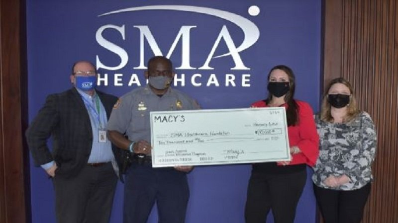 Pictured here: Ivan Cosimi (CEO, SMA Healthcare); Jakari Young (Chief of Police, DBPD); Kristen Twomey (Store  Manager, Macy's); Jennifer Secor (Executive Director, SMA Healthcare Foundation)