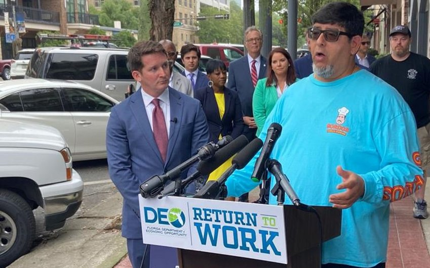 Department of Economic Opportunity Secretary Dane Eagle and Tallahassee restaurant owner Eddie Agramonte appeared at a May news conference about efforts to boost the workforce.