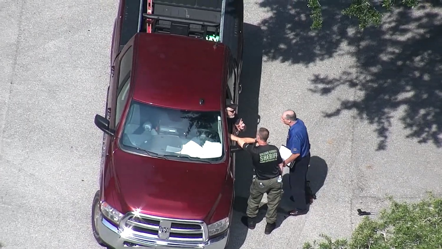 A still shot from a drone showing Volusia Sheriff Mike Chitwood and Deputy Adam Clausen talking with Theodore Melton just before he was taken into custody