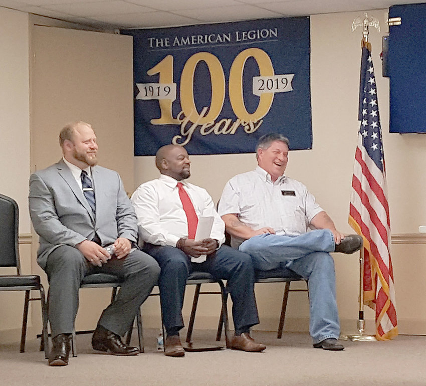 Candidates for Warrensburg City Council share a laugh during a forum held Wednesday, March 27, to help educate voters before the April 2 election. Candidates include Nolan Brooks, Tarl Bentley and Scott Holmberg.