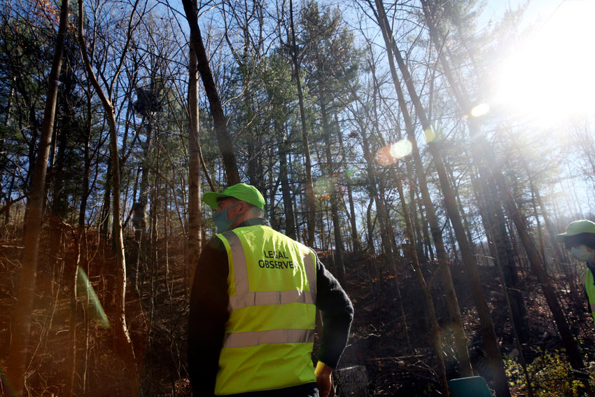Middle photos: Legal observers with the National Lawyers Guild look up toward the Mountain Valley Pipeline right of way, where a construction vehicle could be heard not far from the three tree-sits near Elliston on Monday afternoon.