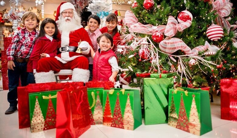 Santa with a group of kids and Christmas presents