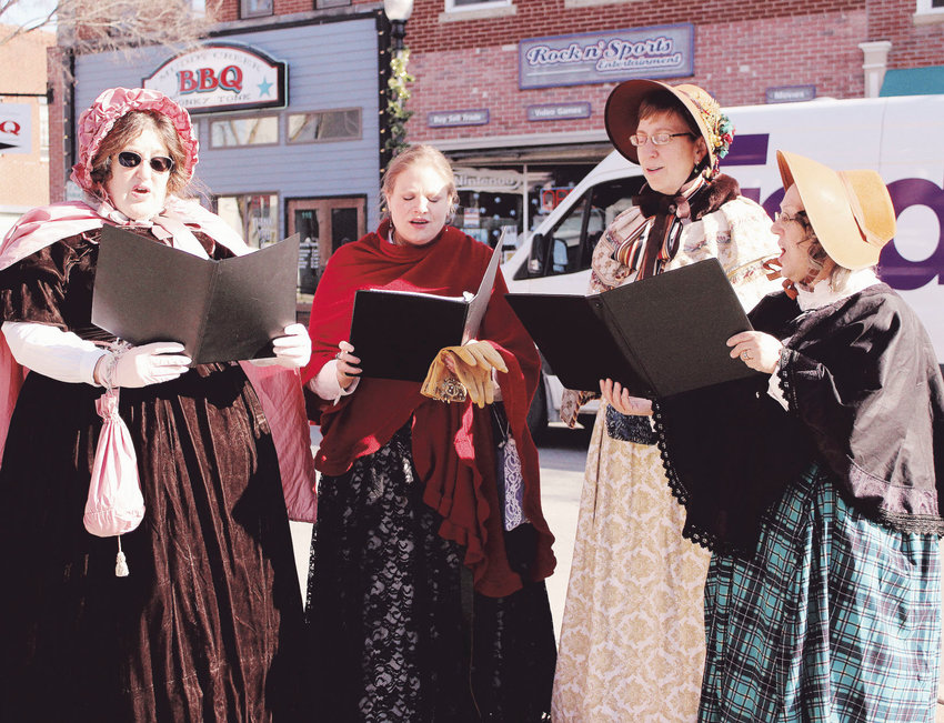 Miriam Rheingold-Fuller, Christina Kitson, Suzy Latare and Cindy Holmberg sing carols during A Dickens Christmas on Saturday, Dec. 7, 2019.