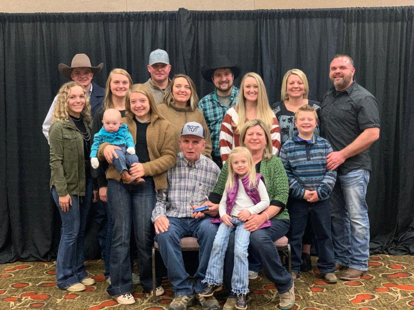 """Rick Anstine, of Kingsville, poses for a photo alongside his family members after he was recognized with the Missouri Cattlemen's Association """"Pioneer Award"""" at its 53rd Annual Missouri Cattle Industry Convention and Trade Show on Jan. 9."""