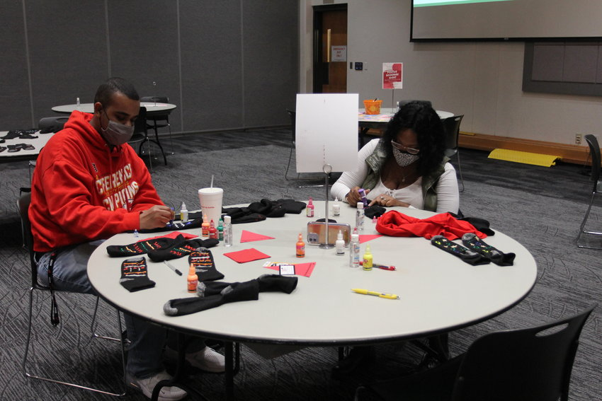 From left, University of Central Missouri students Quinton Dickerson and Shalexis Davis make non-slip socks at the MLK Day of Service on Thursday, Jan. 14, in the Elliott Student Union.