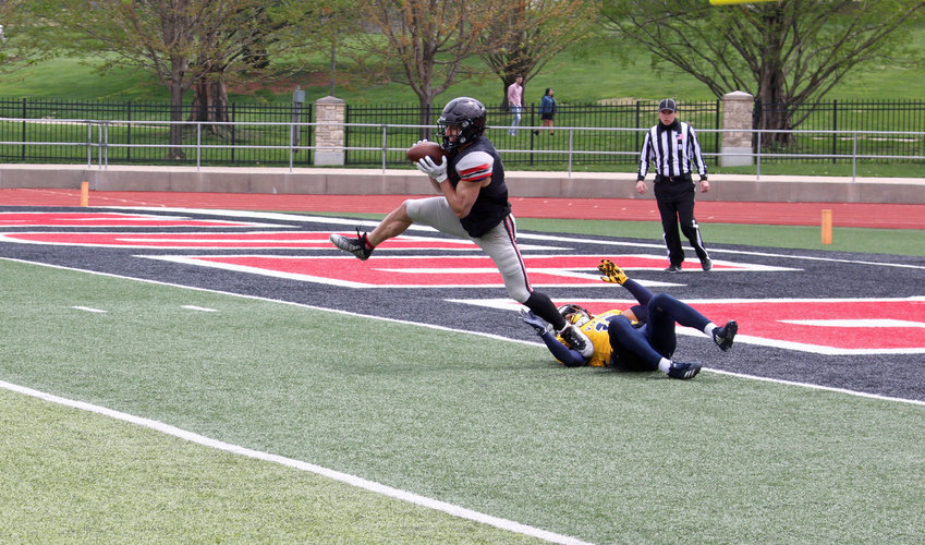 Central Missouri senior wide receiver Drew Slager hauls in a touchdown reception during a scrimmage against Augustana on Saturday, April 17 at Walton Stadium.