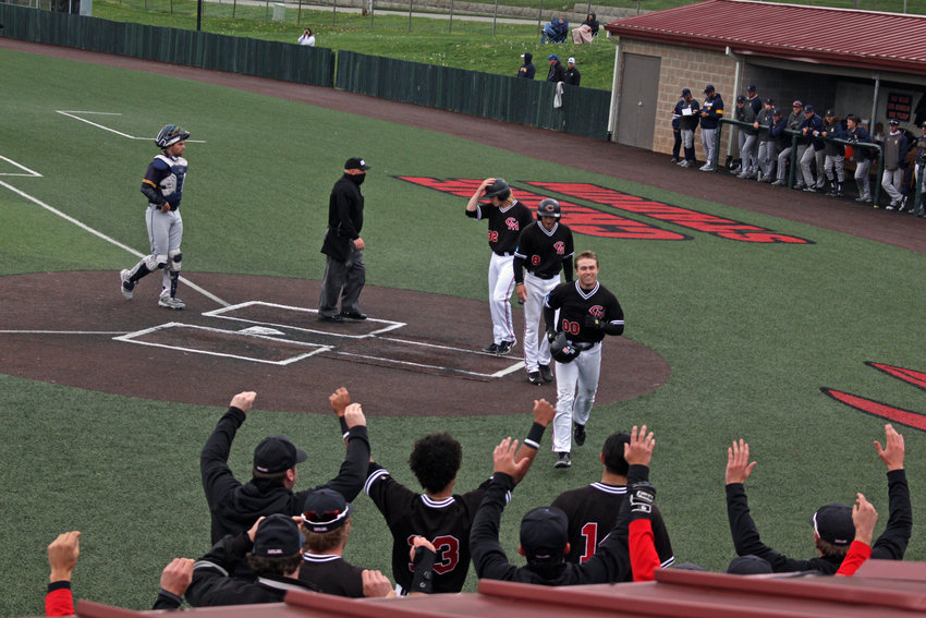 Central Missouri junior Donovan Ditto returns to the dugout after hitting a homer against Central Oklahoma on Saturday, April 17 at Crane Stadium.