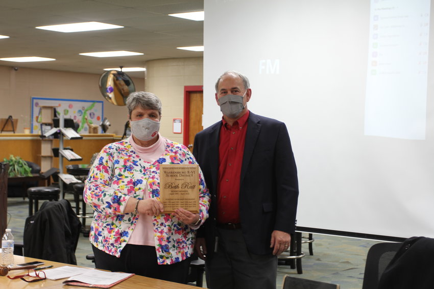 Superintendent Andy Kohl, right, presents Beth Rutt, now former board president, with a plaque commemorating her 30 years of service.
