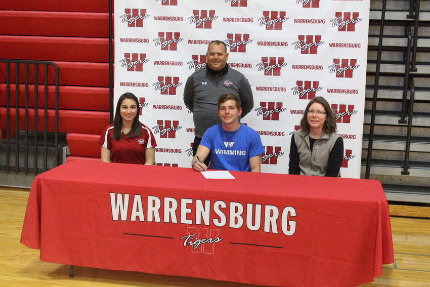 Hayden Vernon signed his letter of intent to swim for Williams Baptist University on Thursday, April 22 during a ceremony at the Warrensburg High School gymnasium.