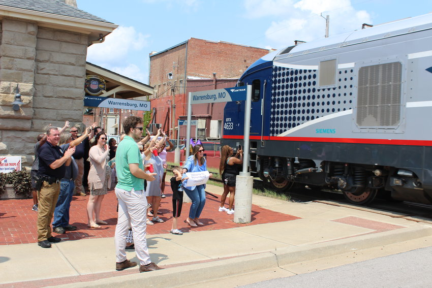 Community members welcome the Amtrak Missouri River Runner as it arrives at the Warrensburg train depot at about noon on Monday, July 19.