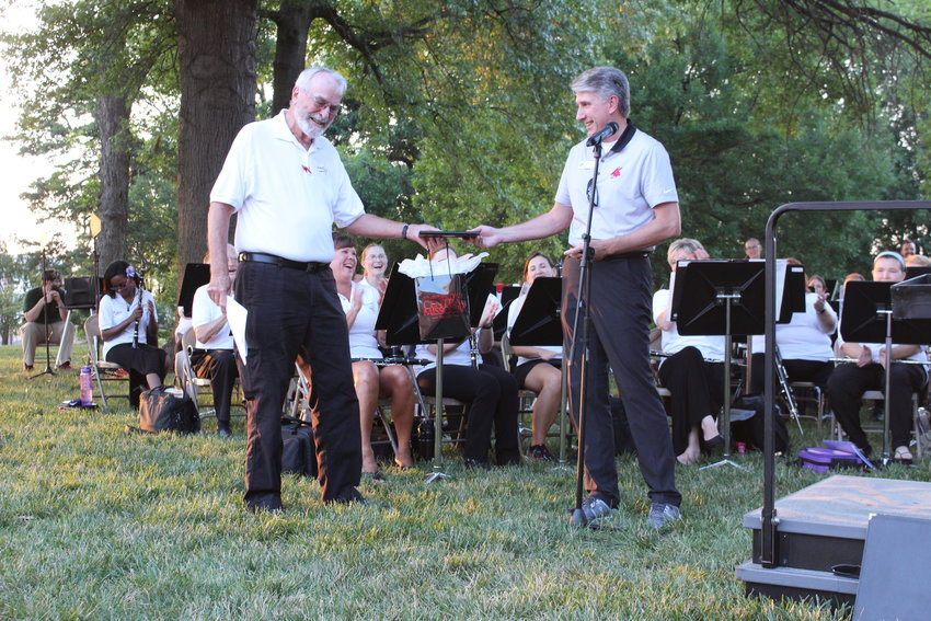 Marion Woods receives gifts from University of Central Missouri President Roger Best during the President's Lawn Concert on Monday, July 26.