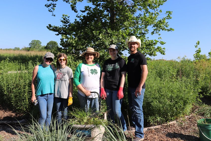 Members of Johnson County 4-H pose for a photo at Turkey Foot Prairie.