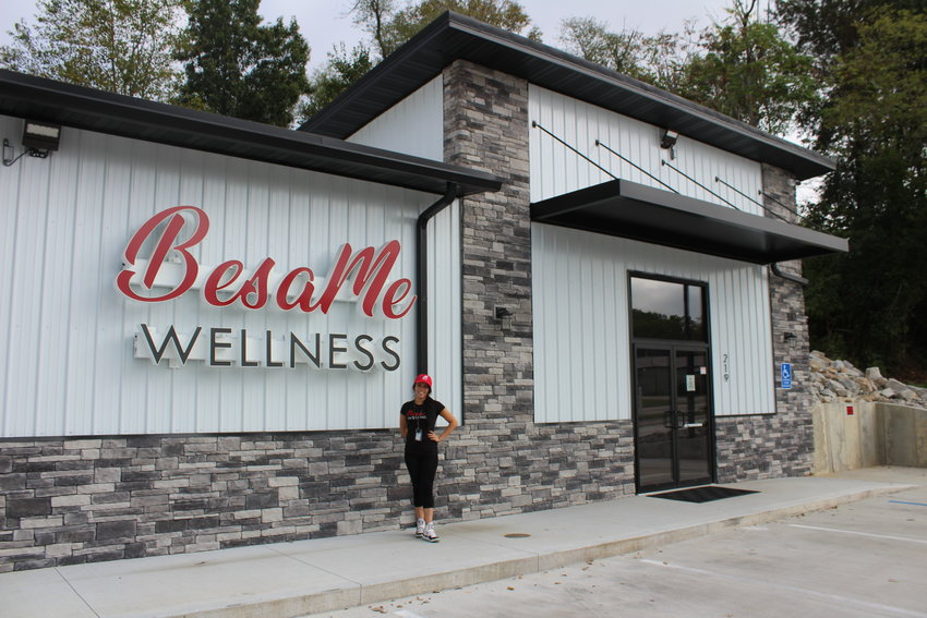 BesaMe Wellness of Warrensburg General Manager Sarah Saltzmann poses for a photo outside the business.