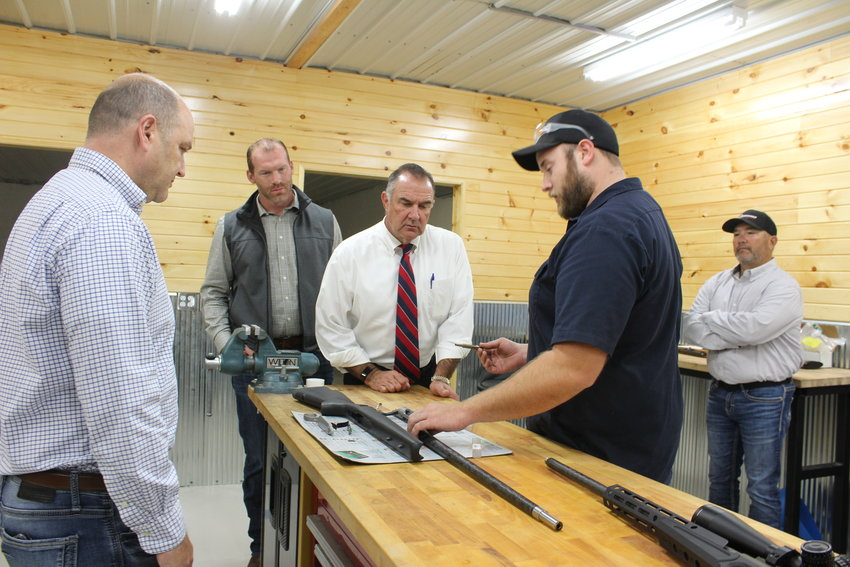 Lt. Gov. Mike Kehoe is shown how a gun is assembled Tuesday, Oct. 12, at Dogwood Shooting Supply.
