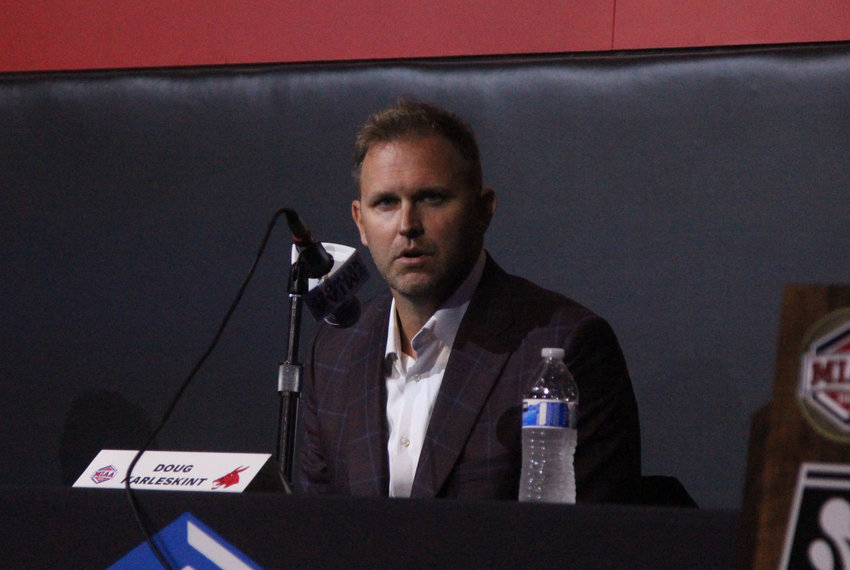 Mules head coach Doug Karleskint speaks from the podium during MIAA Basketball Media Day on Tuesday, Oct. 12, at the College Basketball Experience in Kansas City.