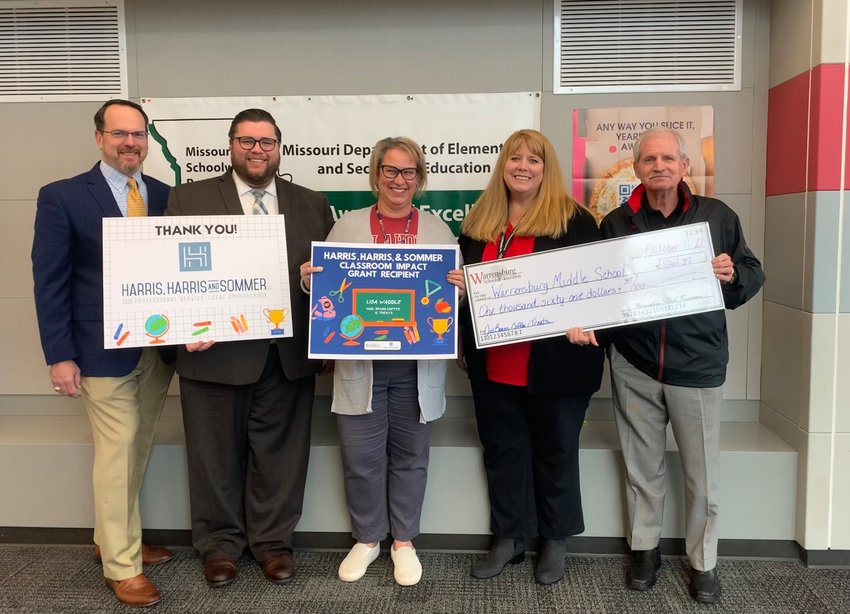 Lisa Waddle is awarded with a Classroom Impact Grant on Monday, Oct. 11. From left, Doug Harris, Adam Sommer, Waddle, Judy Long and Bob Lotspeich.