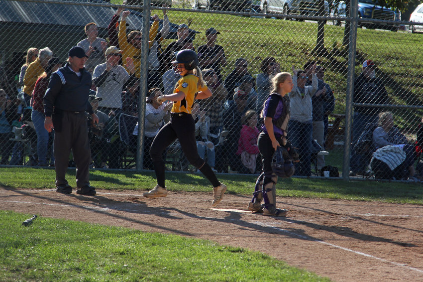 Leeton junior Jadeyn Johnson crosses home plate for the win-clinching run on Saturday, Oct. 16, at Pickering Park in Hermitage.