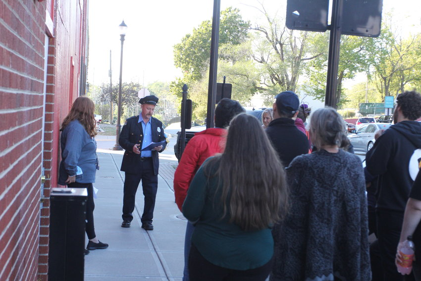 Volunteer Jeremy VanWey explains some of the history behind the original location of the Warrensburg Fire Department during Haunted History on Saturday, Oct. 16, in the 100 block of West Pine Street.